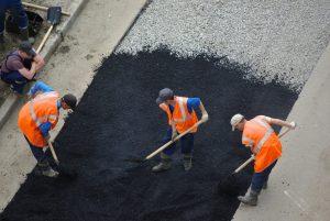 Brampton Paving Workers laying asphalt on the roadway