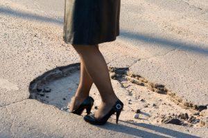 big-pothole-in-asphalt-roadway