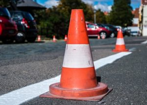frehly-striped-road-with-cone-to-go-around