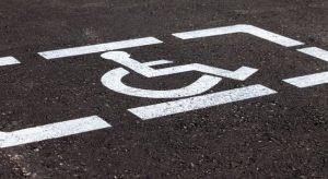White handicap marking on asphalt on the roadway